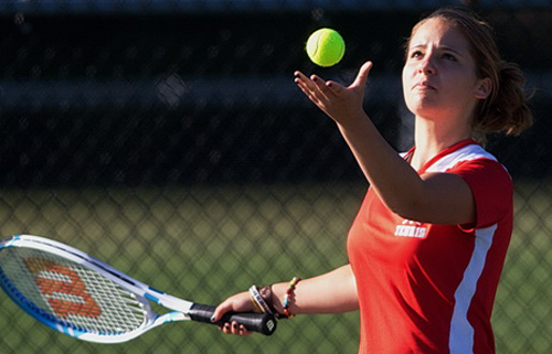 Southold/Greenport junior Julia Daddona tossing the ball before serving during her third singles match against Center Moriches. (Credit: Garret Meade)