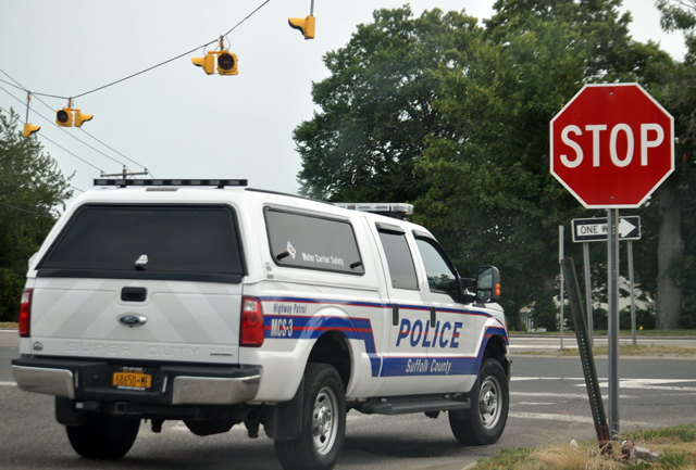 A Suffolk Police vehicle inspects the intersection at Depot Lane and Route 48 in July. (Credit: Grant Parpan, file)
