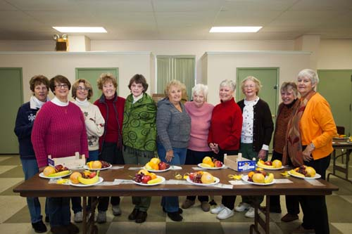 Southold Sunshine Society volunteers including coordinator Peggy Murphy, far right, preparing fruit plates Tuesday morning. (Katharine Schroeder photo)