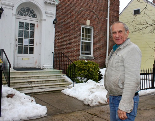 Bill Swiskey states in front of Village Hall. (file photo)