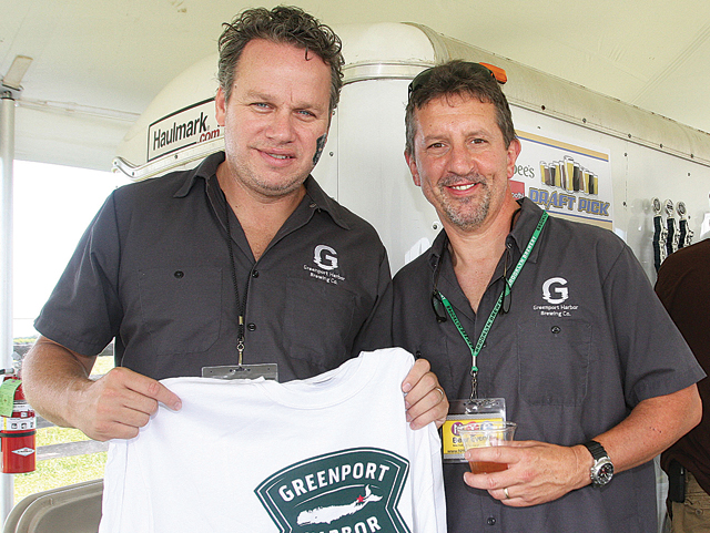 Greenport Harbor Brewing Company co-owners John Liegey (left) and Rich Vandenburgh at their booth during the beer festival this summer. (Credit: Barbaraellen Koch, file)