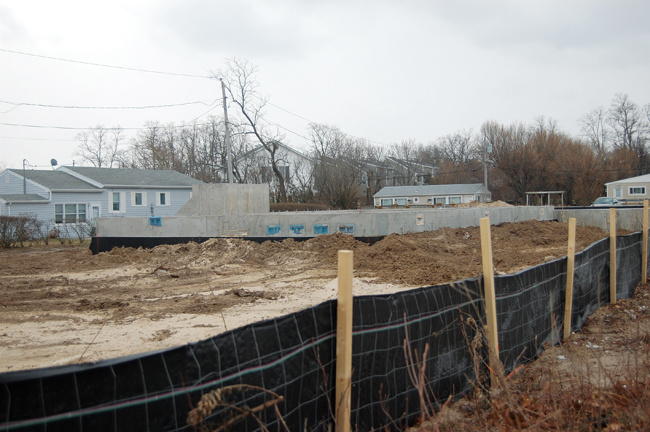 Developer Nick Paleos of Nickart Realty Corp. in Baldwin said the two homes going up along Route 48 near Town Beach in Southold will be finished by July. But they're not for sale. (Credit: Cyndi Murray)