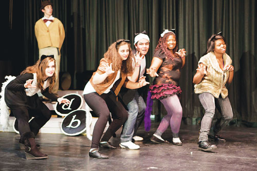 The Greenport High School Drama Club will present the musical 'archy & mehitabel' Friday and Saturday, Feb. 3 and 4, in the school auditorium. The show is based on Don Marquis' series of  New York Tribune columns — about a poetic cockroach and an alley cat — from the 1910s and '20s. Mehitabel, played by Briana Pagano (left), dances with her fellow alley cats while Dan Bunchuck as Archy, the cockroach, watches.