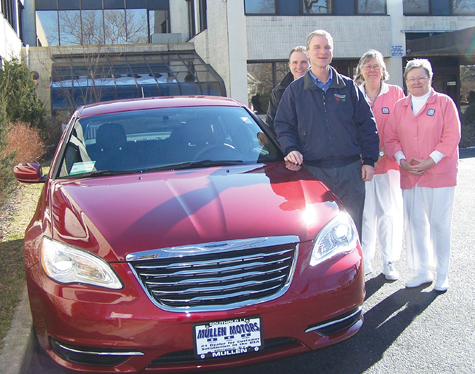Mullen Motors of Southold and the Eastern Long Island Hospital Auxiliary are teaming up for the seventh annual ELIH Car Raffle, with the winner driving home this brand-new Chrysler 200 or pocketing $10,000 in cash. Bill and Rich Mullen (from left) with raffle co-chairs Pat Rushin and Alice Roggie of the Auxiliary; the car is on display on hospital grounds in Greenport. The winning ticket will be drawn at noon on May 18. For tickets, $50 apiece and limited to 900, leave a message at 477-5463 or visit ELIH.org to download an application.