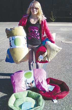 Carly Unger with the dog beds she bought for the Southold Town Animal Shelter with money raised through bake sales.