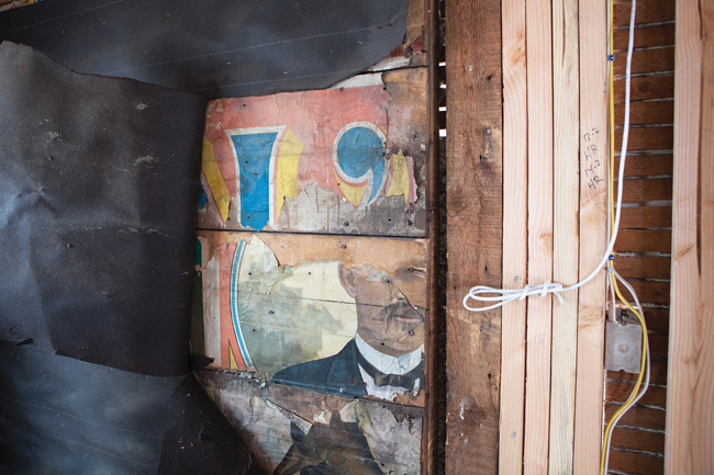 A portion of Walter L. Main's face as it appears inside the kitchen wall as the renovations continue. (Credit: Katharine Schroeder)