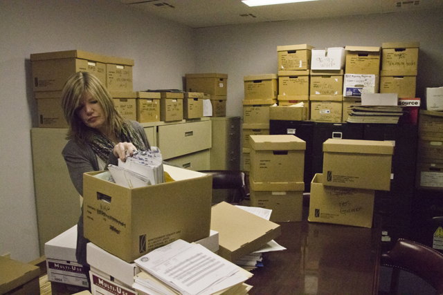 Southold Town Justice Court Director Leanne Reilly thumbs through files in the court's conference room. (Credit: Paul Squire)