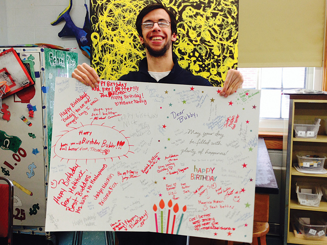Nick Mele helped recruit as many classmates as possible to sign a huge birthday card for a disabled boy in Washington State. (Credit: Mattituck High School)