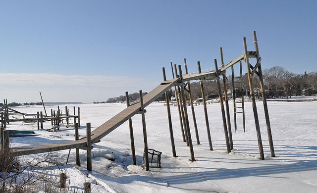 The historically cold winter, and the freezing and refreezing that came with it, have broken and splintered dozen, if not hundreds, of docks that line creeks and other Southold Town waterways. (Credit: Grant Parpan)