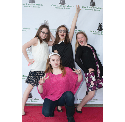 Our Lady of Mercy sixth-graders (from left) Lilly Kneidl, Katie Bohner, Molly Tuthill and Haylie Tierney. (Credit: David Benthal)