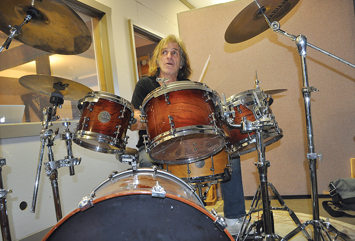 Corky Laing of Greenport rehearses earlier this month at his Southold studio. (Credit: Rachel Young)