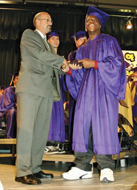 Michael Brown received a standing ovation at his Greenport High School graduation in 2008. (Credit: Greenport Yearbook)