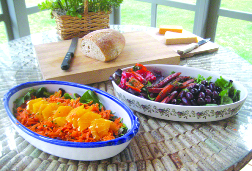 Moroccan carrot orange salad (left) and carrot confit served over arugula with roasted peppers and olives.