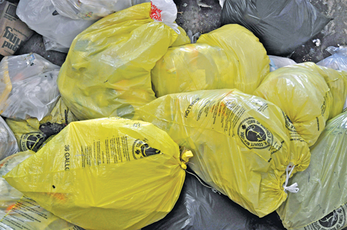 The town recently published an updated brochure on its yellow bag program. (Tim Kelly file photo)