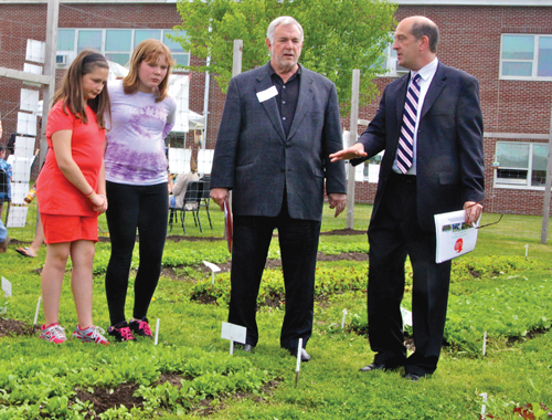 JENNIFER GUSTAVSON PHOTO  |  State Board of Regents member Roger Tilles (third from left) tours the Southold school garden with Superintendent David Gamberg and students Emiliann Palermo (left) and Bryanna Bay during last Thursday's School Garden Expo.