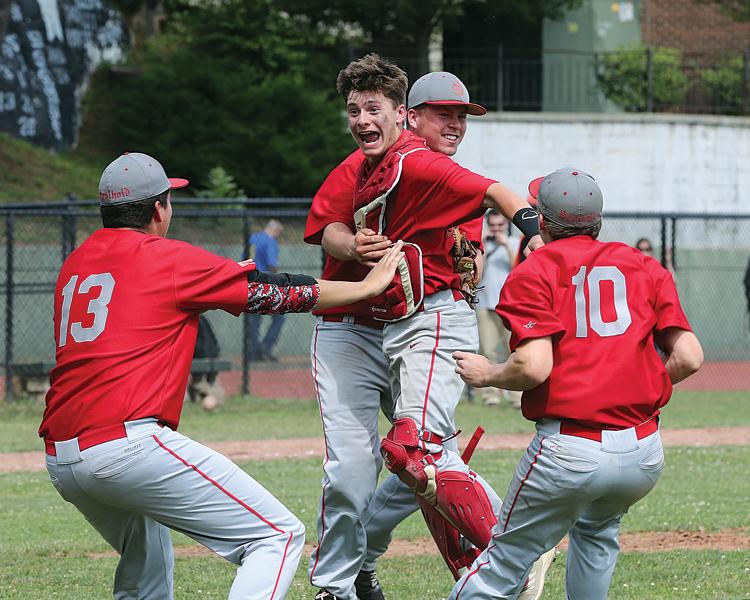 The celebration begins for Southold last year after defeating Tuckahoe in the Class C Baseball Regional Championship game. (Credit: Daniel De Mato)