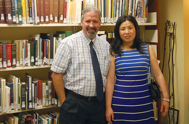 Mattituck-Laurel Library director Jeff Walden and Nancy Li, who passed the United States citizenship exam with the help of a program led by reference librarian Jerry Matovick. (Credit: Nicole Smith)