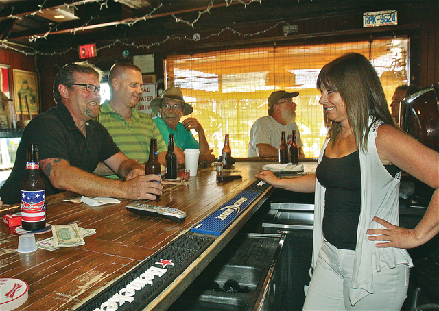 Broken Down Valise bartender Michelle Suarez (right) talks with customers (from left) Scott Nietupski, Jon Allen and Ed Grohoski on a recent Friday. (Credit: Barbaraellen Koch)