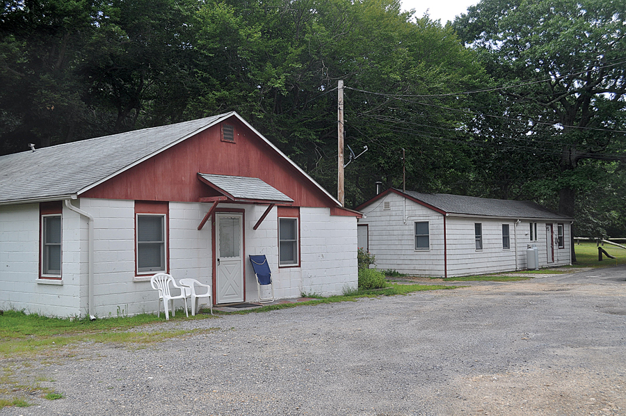 Two of four buildings that house six numbered apartments at the Cutchogue business property where town officials say people are living illegally. The buildings were described in the 1960s as being part of a 'labor camp' where farmworkers lived. (Credit: Cyndi Murray)