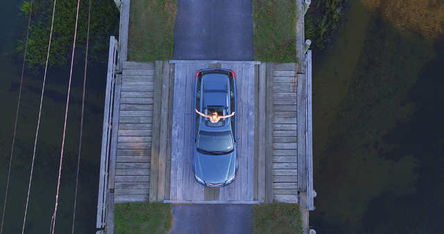 Mary Latham bursts from the sun roof of her mom's 1998 Subaru. (Credit: Jack Kohut/Lifted Sight)