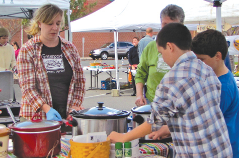 Greenport Farmers Market organizer Lara McNeil serves soup at the farmers market's old location in 2012.