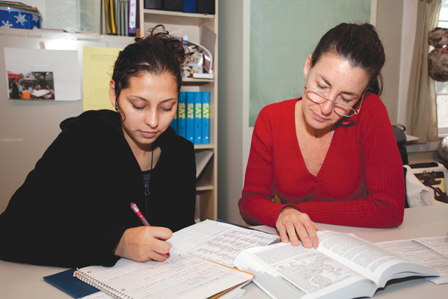 CAST has dedicated much of its resources to tutoring programs that allow students from underprivileged families access to adult mentors for help and homework. This photo, taken in 2011, shows a CAST tutor working with a fromer Greenport High School student. (Credit: Katharine Schroeder, file)