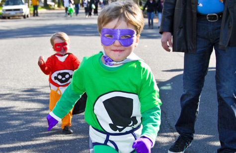 JAY WEBSTER FILE PHOTO | A pair of superheroes take to the streets in last year's Greenport Halloween Parade.