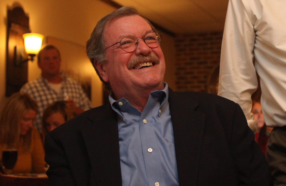Democratic justice candidate Brian Hughes flashes a smile Tuesday night. (Credit: Chris Lisinski)