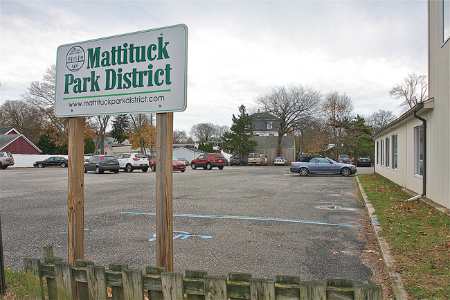The Mattituck Park District says it must either sell this parking lot off Pike Street or develop it as parkland. (Credit: Barbaraellen Koch)
