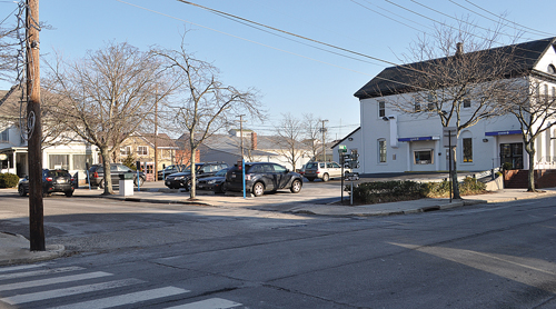 The former Greenport Opera House was demolished in 1956. It's now a Chase Bank parking lot. (Credit: Rachel Young)