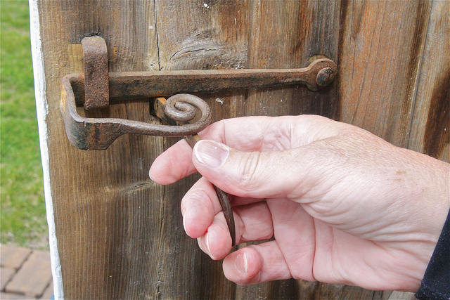 The door to the Fresh Pond Schoolhouse still has its original hardware. (Credit: Barbaraellen Koch)