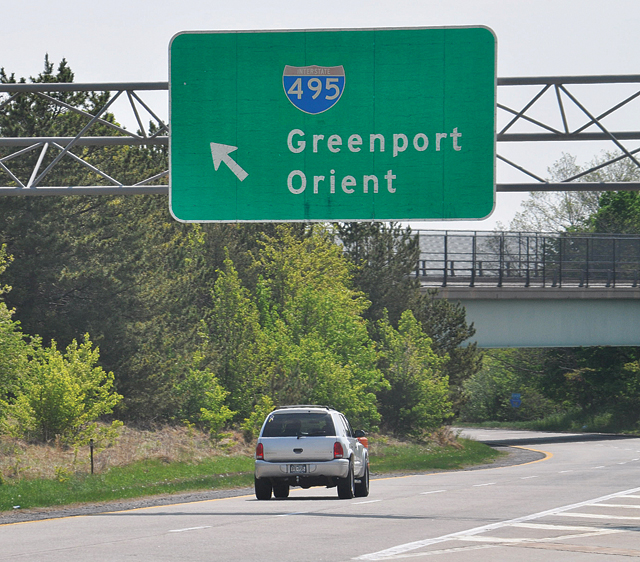 We all know the Long Island Expressway doesn't lead to Greenport and Orient — this is actually a Route 58 sign — but what you might not know is that throughout the 1950s and 1960s many local officials hoped it would. (Credit: Grant Parpan photo illustration)