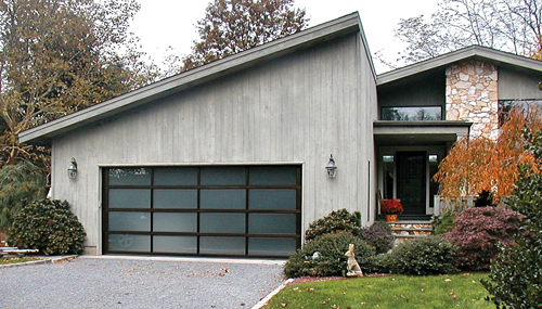 VILLAGE OVERHEAD DOORS COURTESY PHOTO | A Contemporary Style Garage With A Frosted  Glass Door.