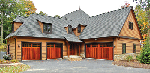 VILLAGE OVERHEAD DOORS COURTESY PHOTO | Multiple Garages With Custom Doors  Made Of Western Red Cedar.