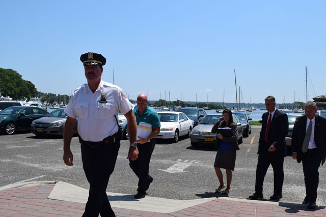 Southold Town police Chief Martin Flatley leads detectives into Eastern Long Island Hospital in Greenport for the arraignment of Steve Romeo Sunday afternoon. (Credit: Vera Chinese)