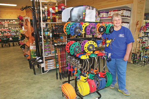 Employee Barbara Zimnoski in the new Long Island Cauliflower showroom, which has a large selection of Dramm professional watering tools, sprinklers and hoses. (Credit: Barbaraellen Koch)