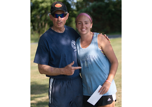 Jim Christy with one of his former players, Molly Kowalski. Christy is stepping down as Mattituck's coach after 33 years. (Credit: Garret Meade)