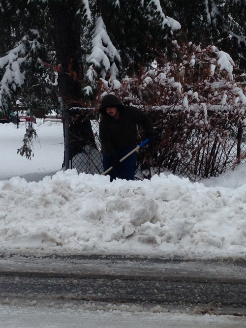 Shoveling along Third Street in Greenport. Cyndi Murray photo.