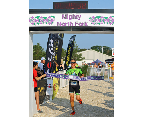 Billy Holl of Bayport, in only his second year in the sport, won the 17th annual Mighty North Fork Sprint Triathlon on Sunday morning at Cedar Beach in Southold. (Credit: Daniel De Mato)