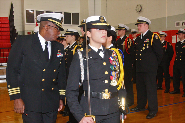 Cadet staff Cadet Commander Andreana Mineo leads Commander Jimmie Miller as he inspects Cadet staff.
