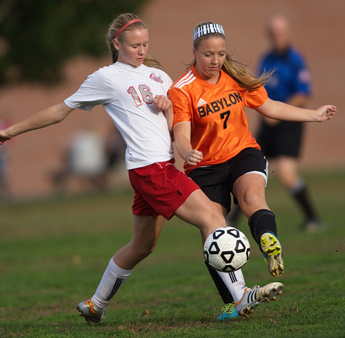 GARRET MEADE PHOTO  |  Southold/Greenport midfielder Megan Van Bourgondien fights for the ball against Babylon's Hallie Merz Tuesday afternoon.