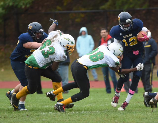 A Wyandanch player makes a tackle during the team's 54-0 loss to Shoreham-Wading River Oct. 11. (Credit: Robert O'Rourk)