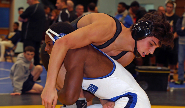 Mattituck's Tanner Zagarino (top) wrestles against Raheem Brown of Riverhead Saturday in the 170-pound finals of the North Fork Invitational. (Credit: Daniel De Mato)