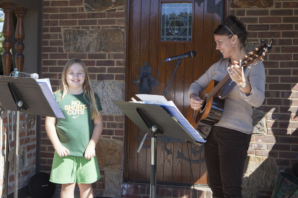 Maya Hamilton, 10, of Cutchogue sings with Patti Homan.