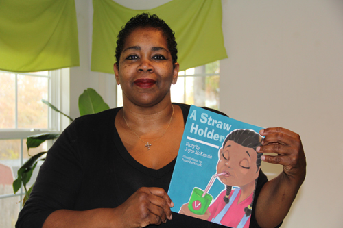 "CARRIE MILLER PHOTO | Newly published author Joyce McKenzie said her book,  ""A Straw Holder,""  is based on her granddaughter who loses her first tooth."