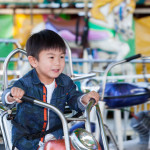 Christopher Yeung, 3, of Great Neck rides the motorcycles