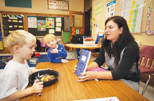 KATHARINE SCHROEDER FILE PHOTO | Preschool teacher Jen Skuggevik teaches writing to students in Greenport.