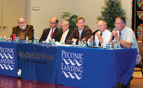 KATHARINE SCHROEDER PHOTO | Trustee candidates debate issues like water pollution and beach access during Tuesday's forum.