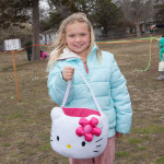 Hannah Johnson, 8, of Cutchogue brought along her Hello Kitty basket to collect eggs.
