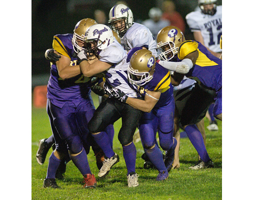GARRET MEADE FILE PHOTO  |  The Greenport defense of (from left) Codey Fisher, Jared Schenone and Gene Allen bring down a Port Jefferson runner earlier this season in what was the Porters' fourth straight win.